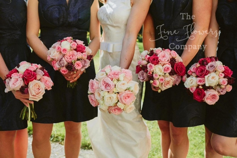 bridal and bridesmaids bouquets of ivory, blush and dusky bright pinks, from wedding at Hampton Court House