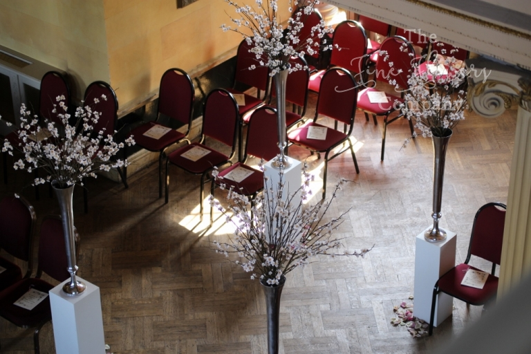 wedding aisle with cherry blossom, from hapmton Court House wedding ceremony, spring 2014
