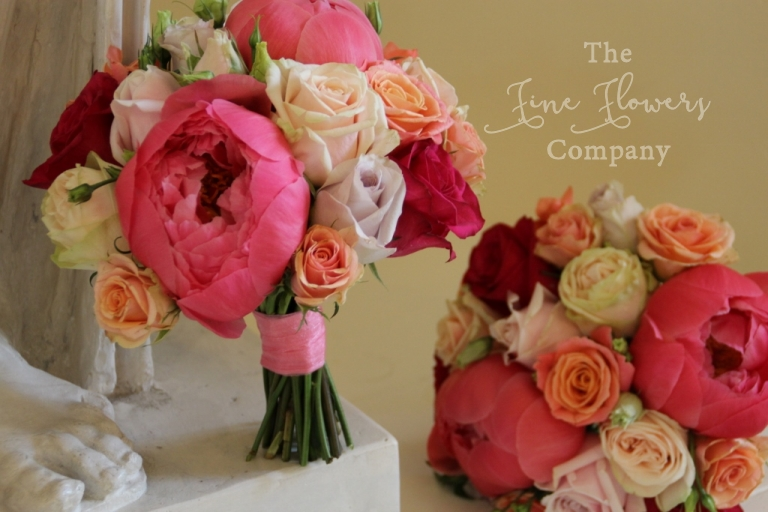 coral and pink and cream bridal boquuets roses and paeonies.
