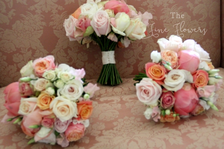ivory, peach, pink and coral bridesmaids bouquets from wedding at Highclere Castle