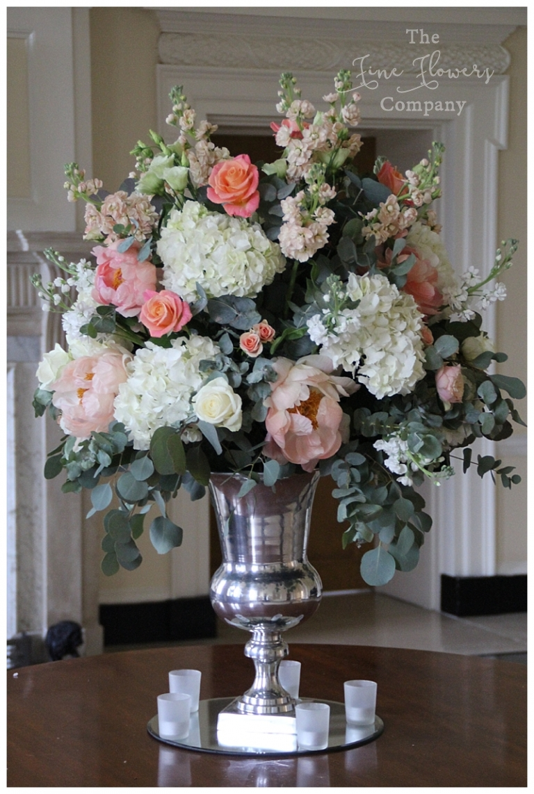 coral pink wedding flowers at botleys mansion, entrance table flowers floral display at botleys mansion wedding
