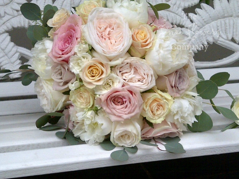berkshire wedding flowers - vintage bridal bouquet of roses, spray roses and silver eucalyptus. From Cowrth Park wedding.