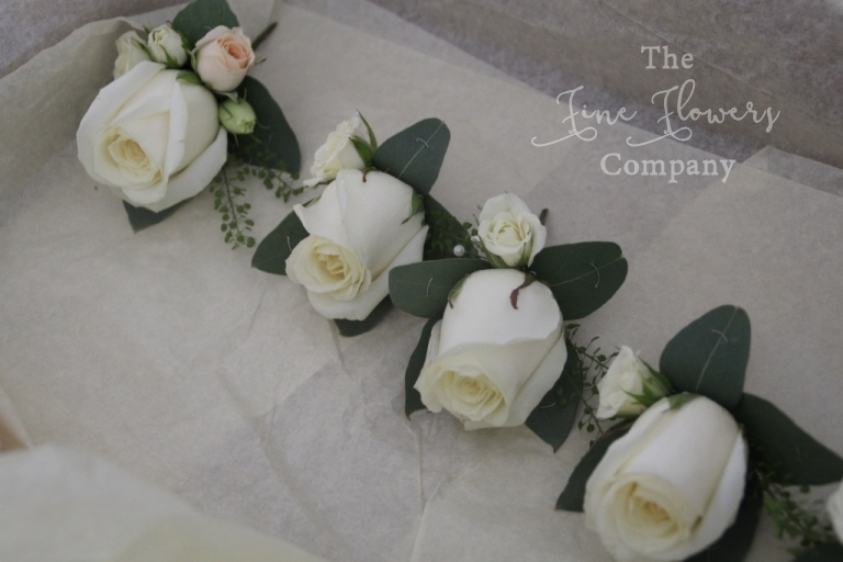 ivory avalanche rose buttonholes with ivory spray roses, mens white rose buttonholes, grooms white rose buttonhole grooms ivory Avalanche rose buttonhole.