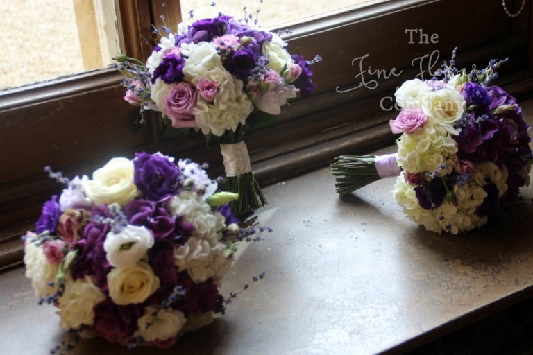 wedding flowers at Highclere castle - bridal and bridesmaids bouquets, ivory and purple lilac wedding flowers. berkshire wedding
