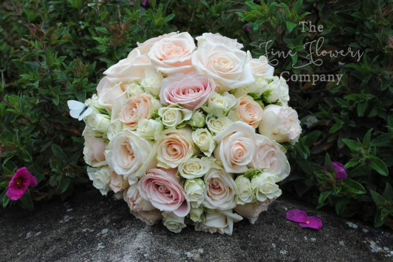 cream and blush roses bridal boquuet from Cain Manor wedding