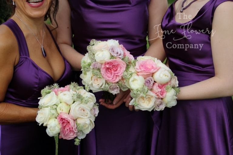 ivory, blush and pale pink roses paeonies and astrantia bridesmaids bouquets, plum wedding colour theme, bridesmiads flowers wearing plum. Coworth Park wedding flowers.