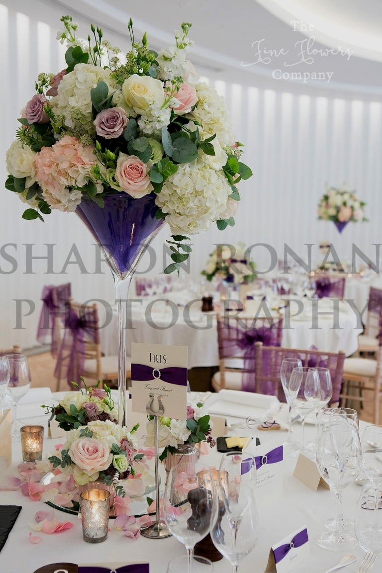 Beautiful vintage wedding flowers at coworth park tall martini vase centrepieces with ivory blush pink flowers and reviewsmspy