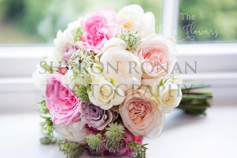 vintage bridal boquuet of ivory and blush O'Hara roses, Sweet Avalanche roses, astrantia and paeonies. From wedding at Coworth Park Berkshire.