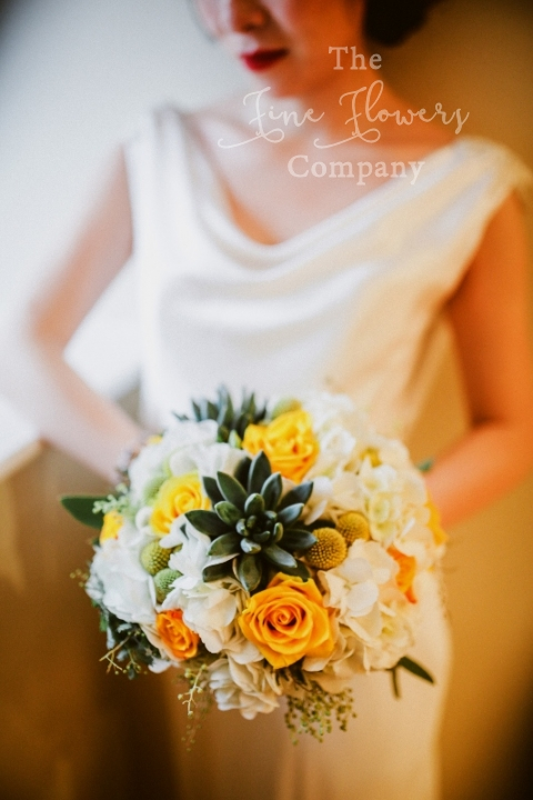 bridal bouquet with succulents, mimosa, hydrangeas and gold yellow roses.