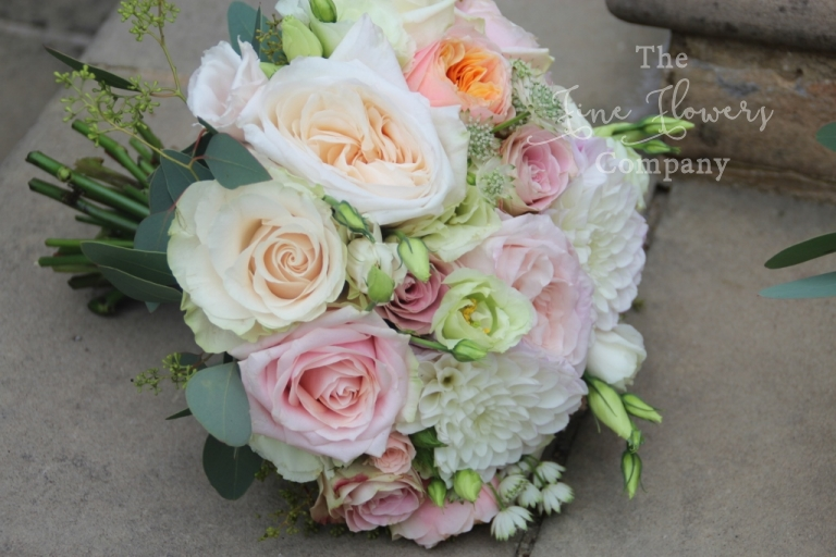 bridal handtied bouquet of ivory, cream, dusky pink and coral pink roses, sprya roses, lisianthus and dahlia. Vintage summer bridal bouquet