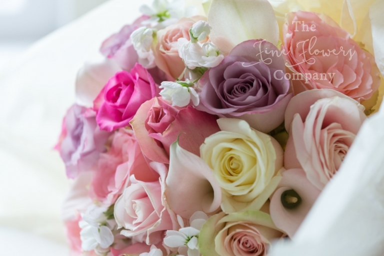 ivory and pink, blush and lilac bridal bouquet of roses and blush calla lilies.