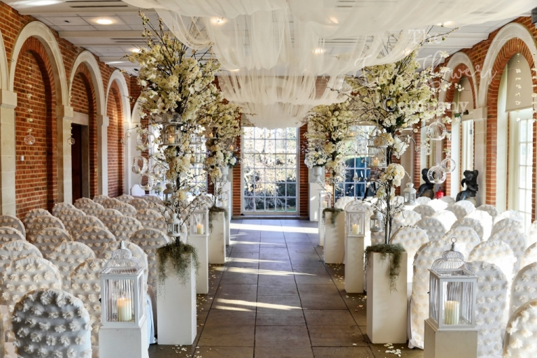 wedding aisle ideas, romantic draped wedding aisle, wedding aisle with tall trees, wedding aisle with huge towering flower trees and overhead tule canopy, great fosters spring open day ceremony flowers, Great Fosters wedding trees. Wedding trees for hire Surrey