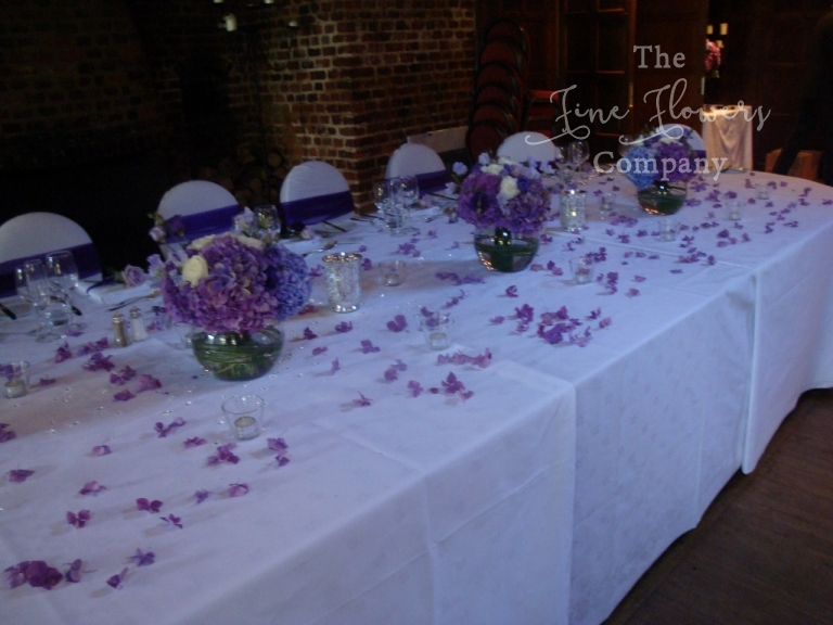 Oval Top Table Wedding Flowers At Great Fosters In Surrey Deep Purple