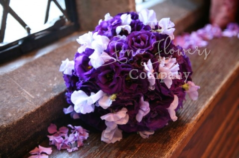 purple lisianthus and lilac sweet peas bridal bouquet, deep purple bridal bouquet.