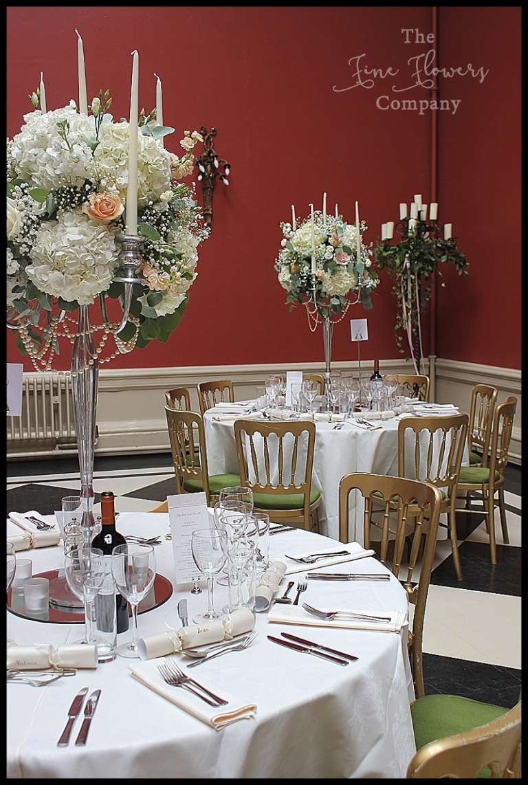 Surrey Wedding Flowers Ivory And Peach Centrepieces Tall Silver Candelabra With Roses