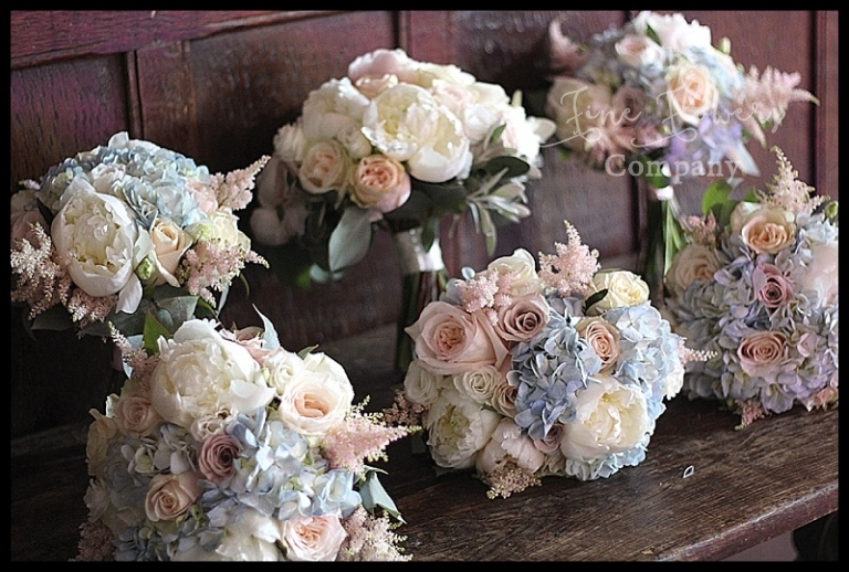 ivory, b;ush, nude pink and hint of pale blue bridesmaids bouquets from wedding at Great Fosters.