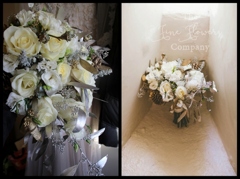 wintry winter ivory and gold tear drop bouquet with pine cones, berried eucalyptus, avalanche roses, lisianthus and spray roses.