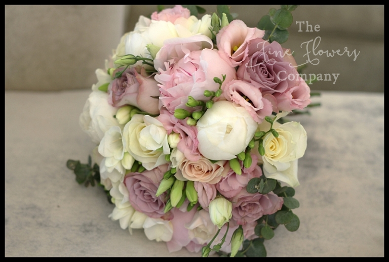 bridal handtied bouquet of pink sarah bernhardt paeonies, ivory paeonies, blush pink roses, lilac Memory Lane roses, scented freesias and lisianthus.