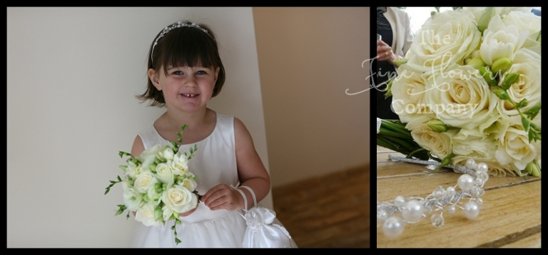 flower girls posy of ivory white roses and scented freesias.