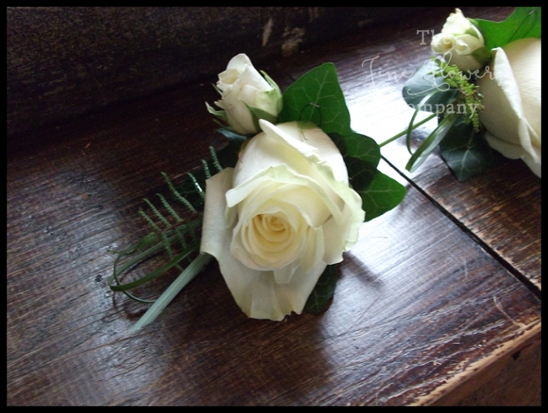 avalanche rose buttonhole with ivory spray rose and fern