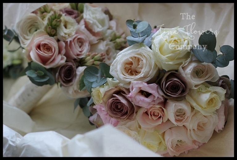 ivory blush and vintage pink bridal bridesmaids bouquets with Amnesia roses, O'Hara roses, Sweet Avalanche roses, ranunculus and silvery eucalyptus