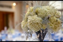wintry white sparkly silver wedding flowers centrepiece of ivory hydrangeas, white asparagus fern, sparkly silver twigs and thlaspi green bell, with silver foliage. from winter wedding at Botleys Mansion