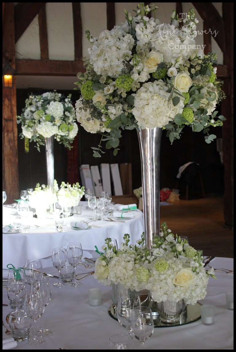 Classic white green wedding flowers at great fosters the fine white and green tall lavish wedding centrepiece table display with ivory white weddings great fosters mightylinksfo