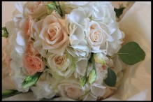 ivory, cream and pale blush bridal bouquet of roses, hydrangeas, spray roses and lisianthus. From wedding at Botleys Mansion in Surrey
