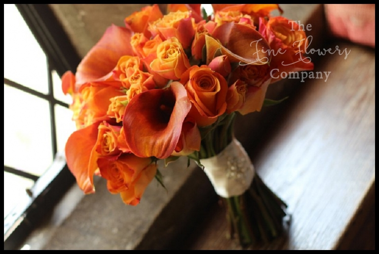 bright burnt orange calla lilies and orange roses bridal bouquet
