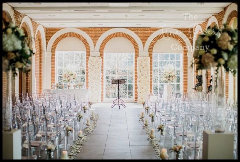 great fosters wedding ceremony with ghost chairs - clear acrylic chairs