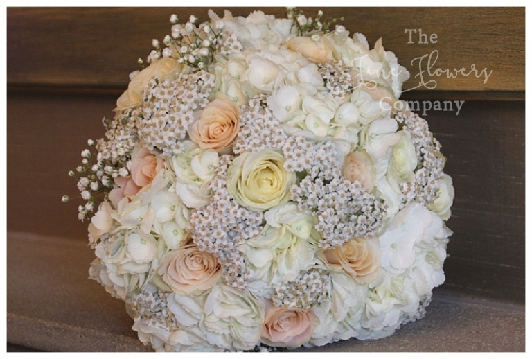 ivory and peach bridal bouquet of roses, hydrangeas and gypsophila