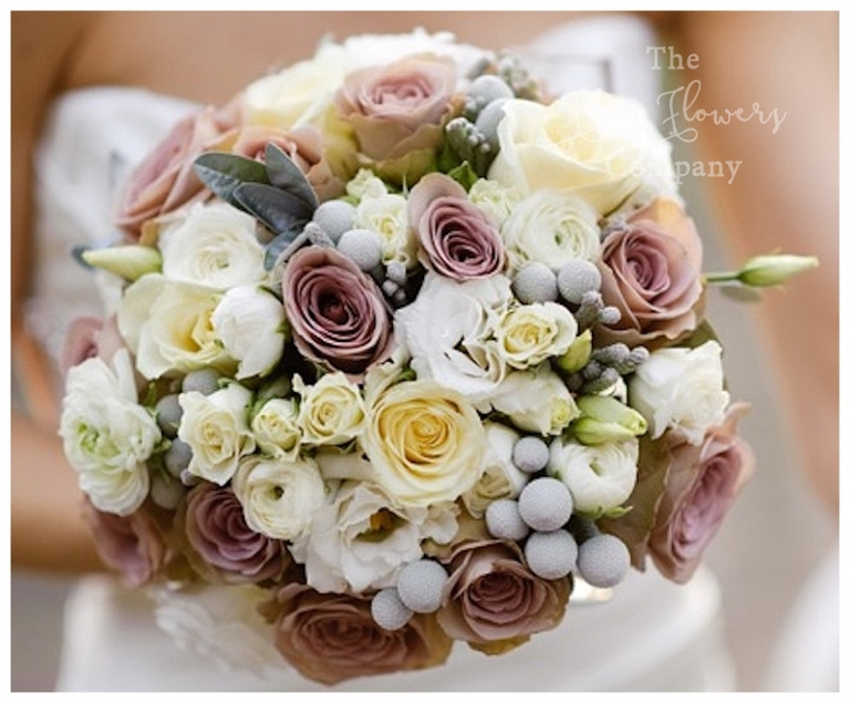 winter wedding with vintage pink Amnesia roses, silvery brunnia berries and ivory roses and lisianthus