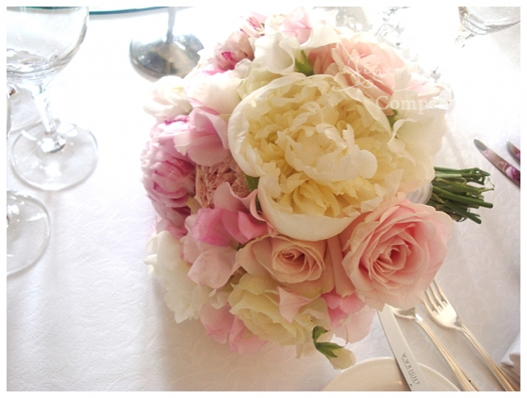 bridal bouquet of white peonies, pink peonies, blush pink roses and sweet peas.