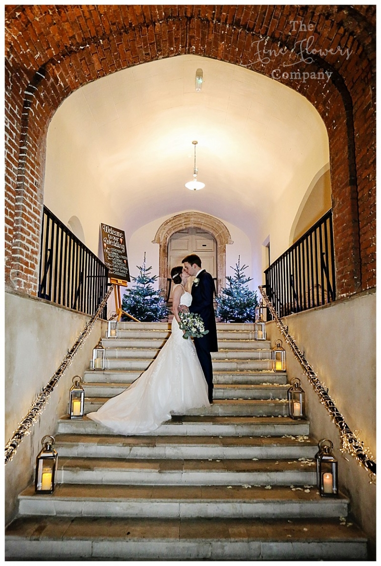 wedding photos of stairs at Farnham Castle. Lanterns on the steps at farnham castle.