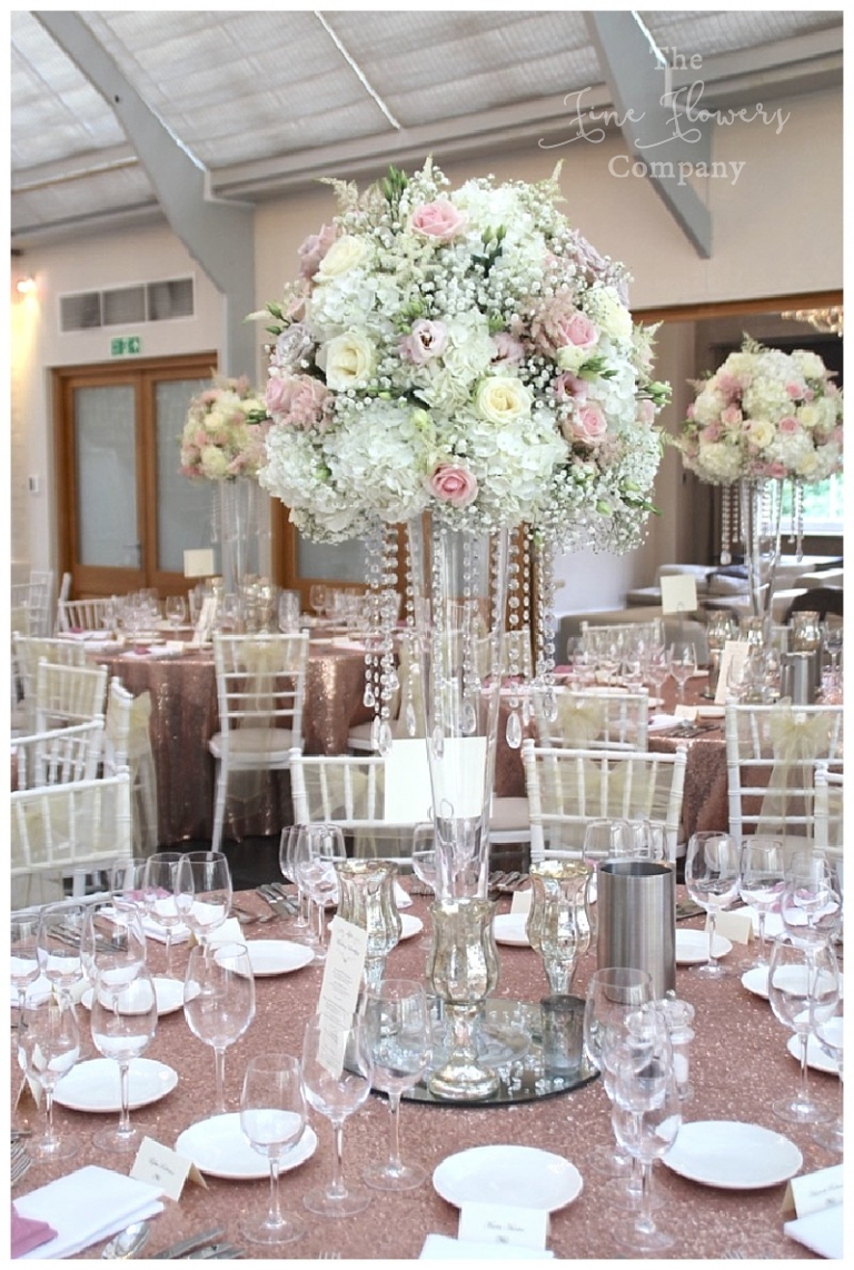 botleys mansion gatsby inspired floral displays with tall glass vase and draping crystals strands.