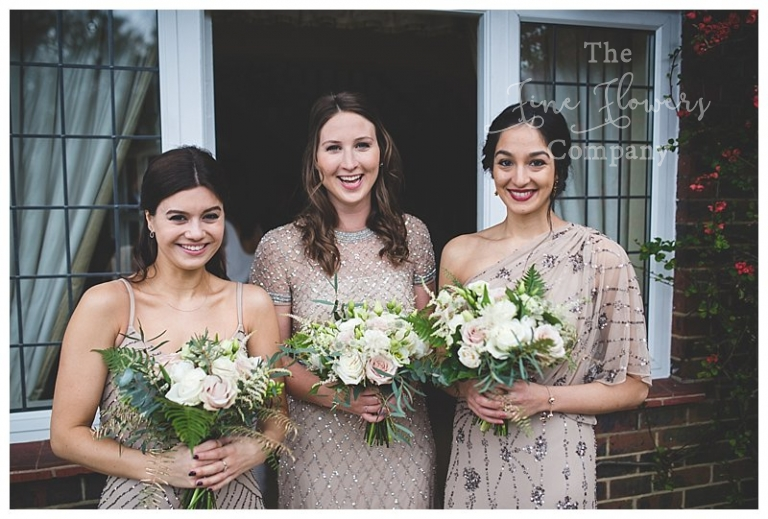 champagne gold nude pink bridesmaids dresses with ivory and nude pink botanical bouquets.