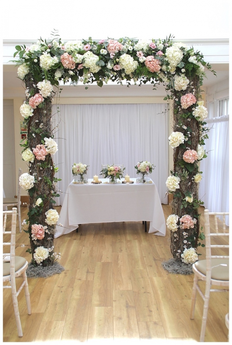 Rustic wedding arch at Pembroke Lodge - The Fine Flower Company