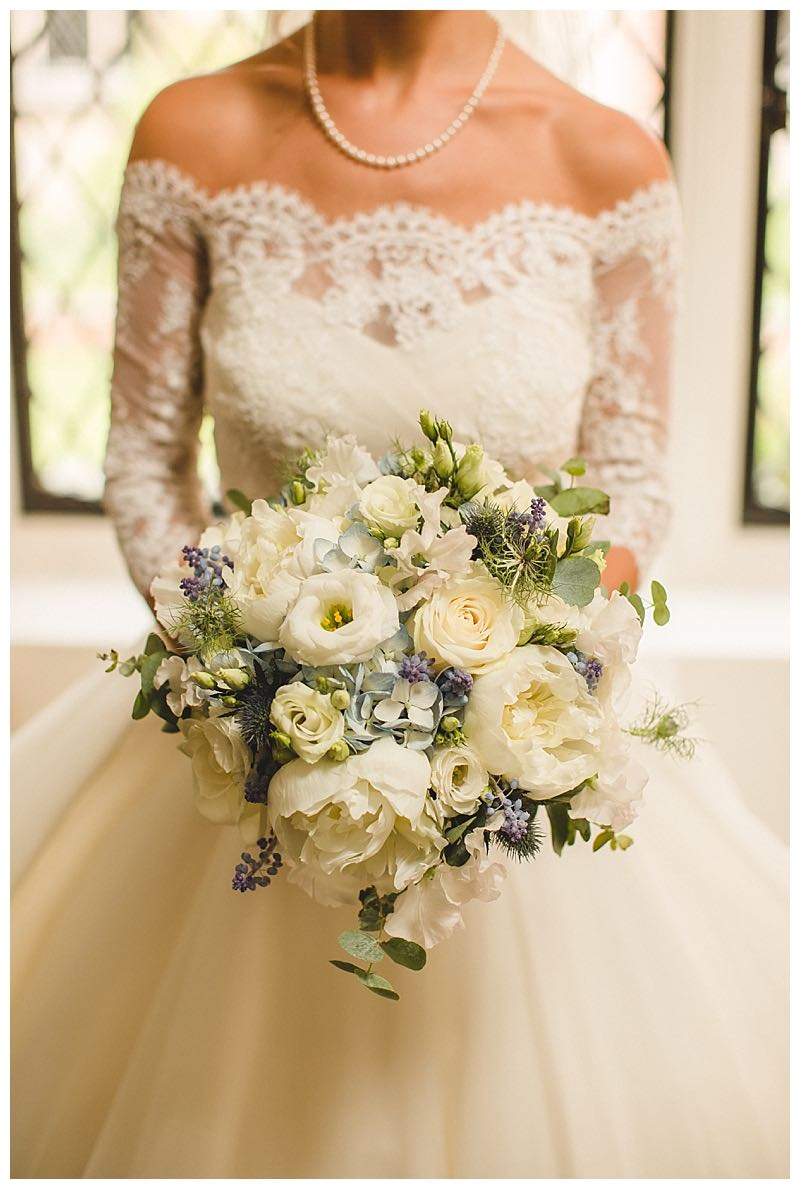 wedding flowers surrey, great fosters wedding flowers, ivory and pale blue bridal bouquet, peonies roses, muscari and eucalyptus bridal bouquet, wild and textural bouquet, loose bridal bouquet