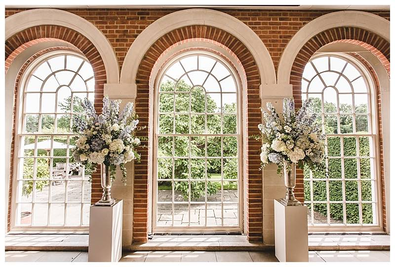 wedding ceremony pedestals, wedding ceremony flowers, ivory and pale blue wedding flowers, Great Fosters wedding,