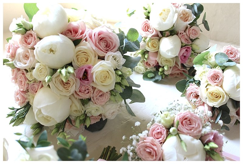 roses and peonies bridal and bridesmaids bouquets, with spray roses and eucalyptus, from surrey wedding at Farnham Castle