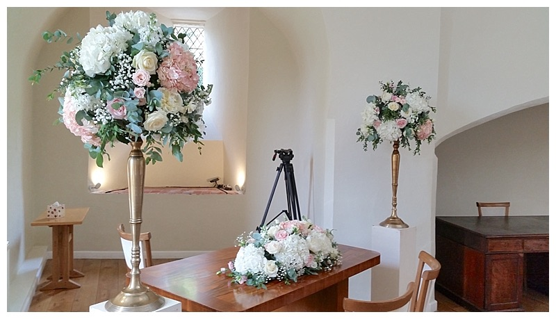 farnham castle wedding ceremony flowers in the lantern hall, ivory and blush wedding flowers centrepieces.