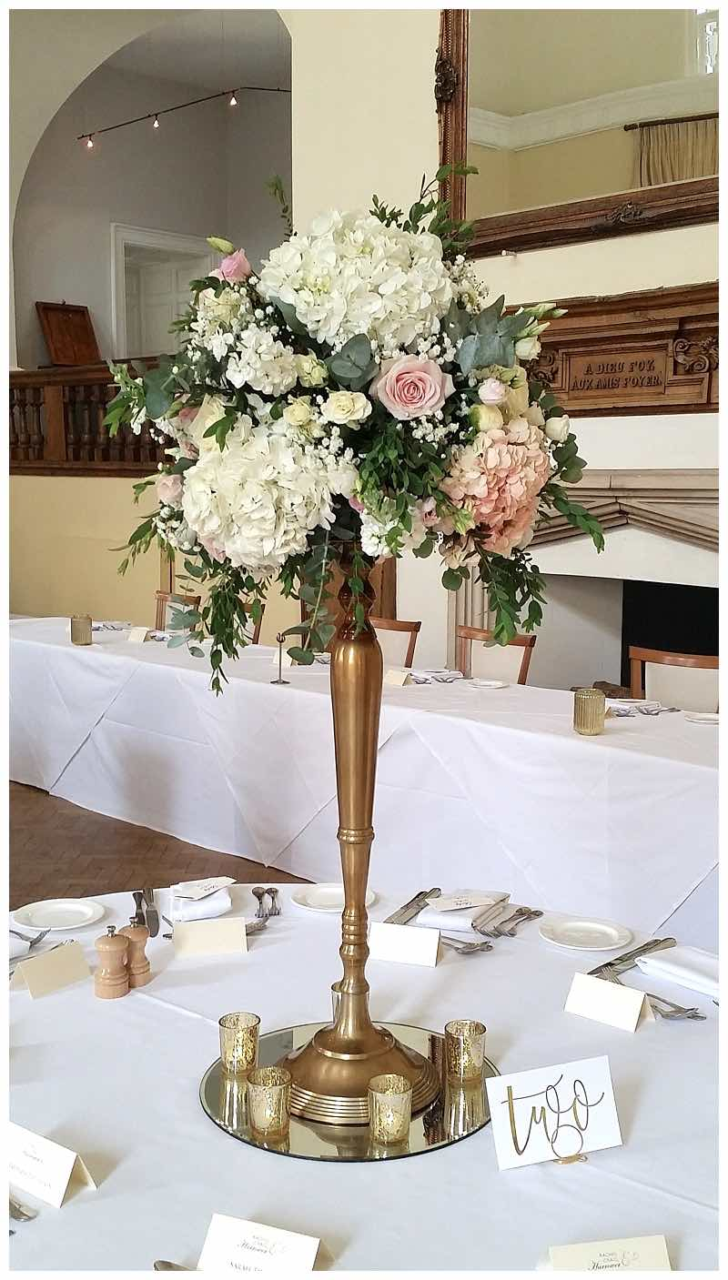 antique gold candelabra centrepiece at Farnham Castle summer wedding