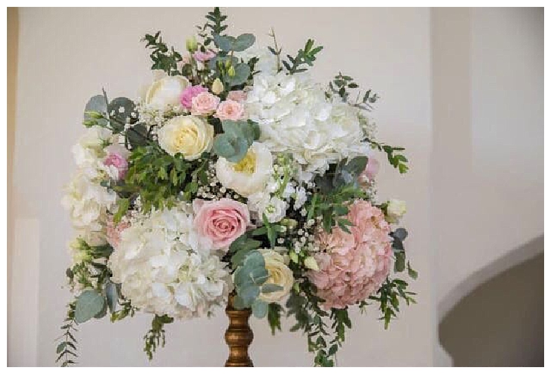 ivory and blush pink roses, peonies and hydrangea candelabra centrepiece with antique gold candelabra