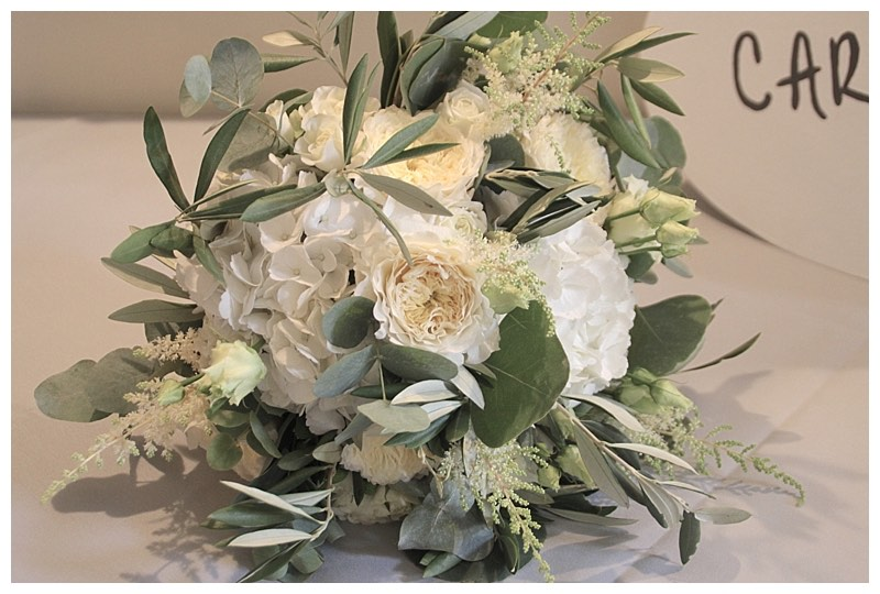loose organic botanical bridal bouquet with ivory white david austin patience garden roses, hydrangeas and olive and eucalyptus.