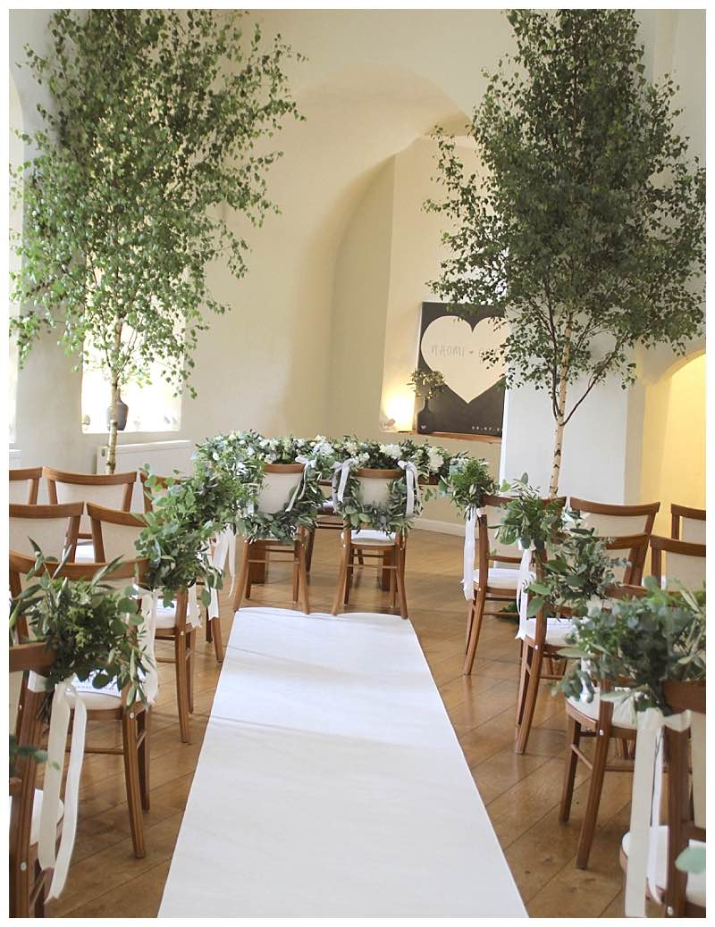 silver birch trees wedding ceremony flowers and foliage aisle. green wedding aisle. Florist at Farnham castle.