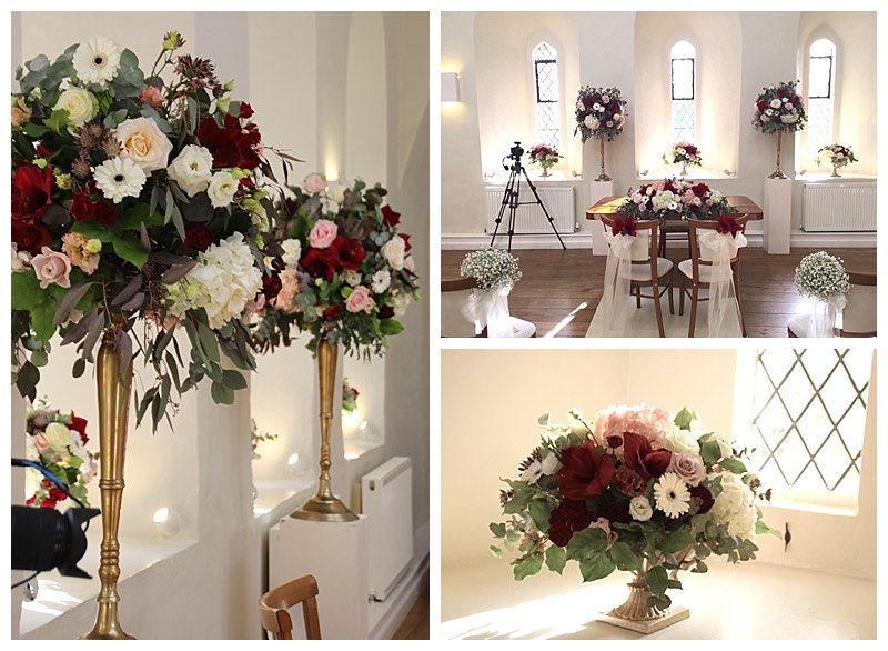 farnham castle wedding ceremony flowers with burgundy, blush and ivory Lantern hall wedding ceremony flowers.