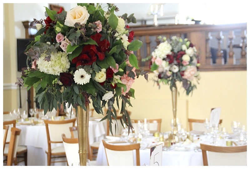 farnham castle wedding candelabra flower displays, gold candelabras at Farnham castle wedding