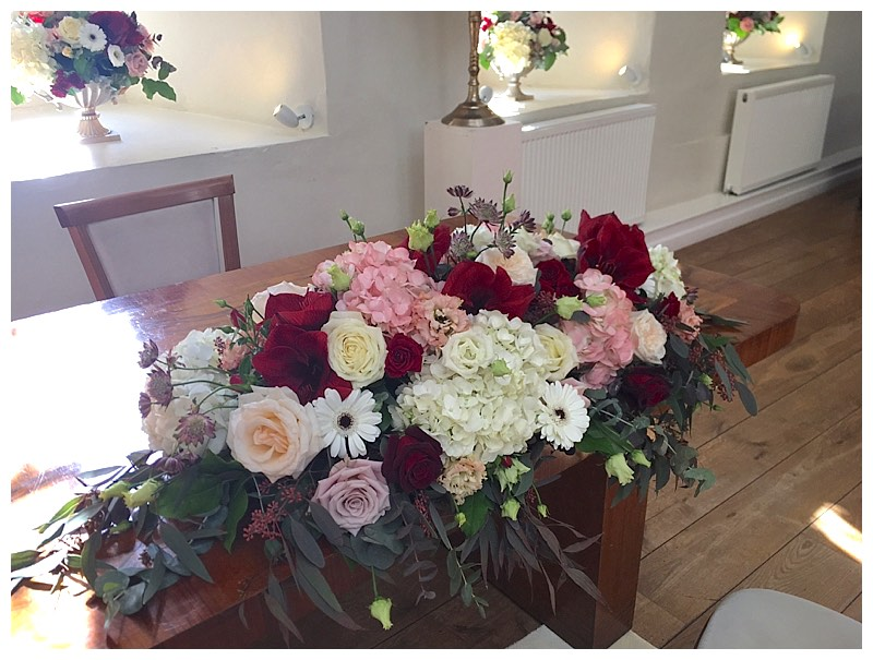 burgundy blush and cream long top table or ceremony table centrepiece.