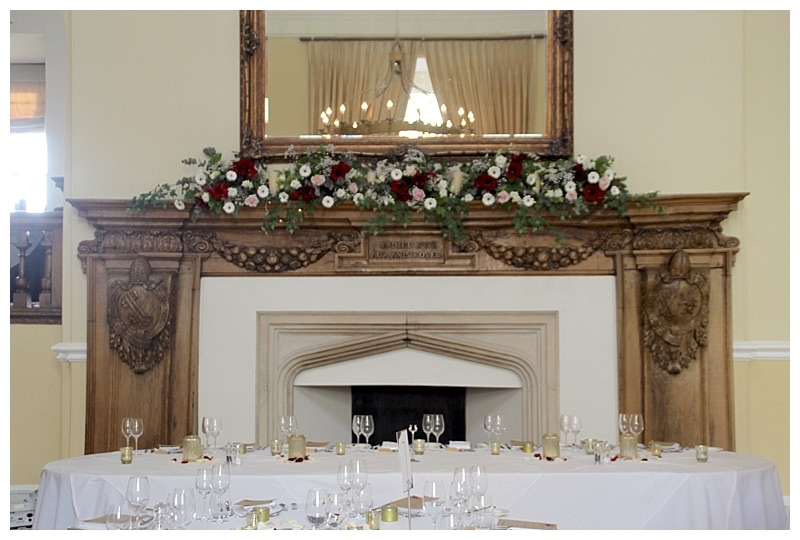 farnham castle wedding flowers, mantlepiece fireplace flowers at Farnham castle, farnham castle wedding florist.