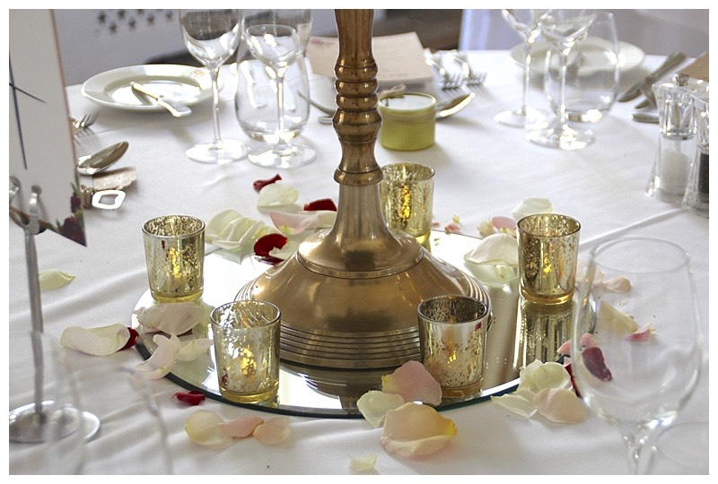 antique gold candelabra hire with mercury glass votives around.